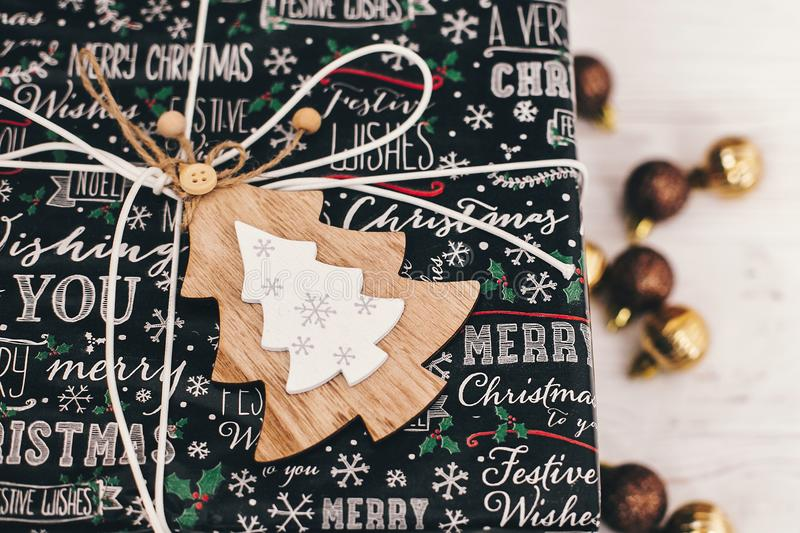 Merry christmas and happy new year concept. stylish wrapped gift royalty free stock photo