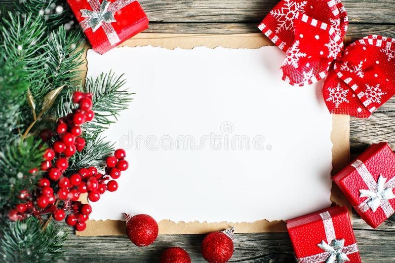 Merry Christmas and happy New year. Cup cocoa, cookies, gifts and fir-tree branches on a wooden table. Selective focus royalty free stock photos