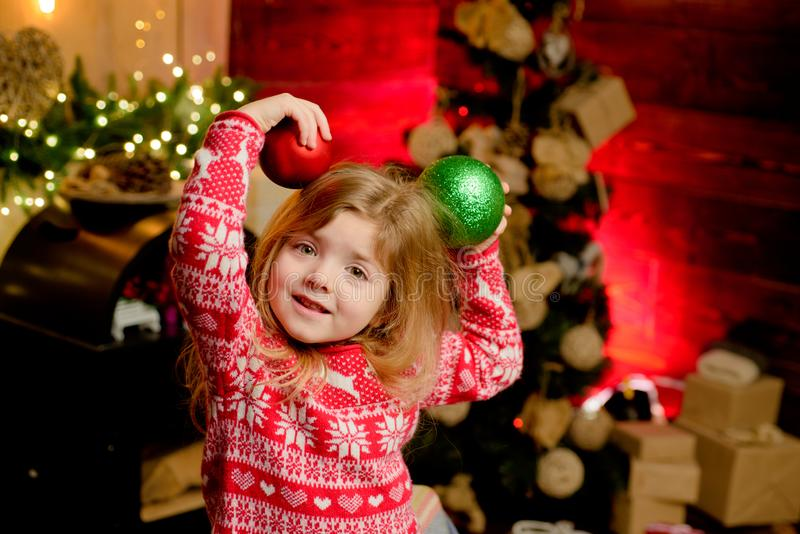 Merry christmas and happy new year. Cute little child girl play ornaments balls christmas tree. Kid enjoy winter holiday stock images