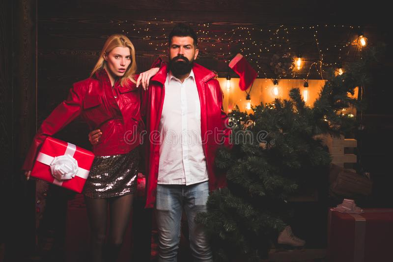 Merry Christmas and Happy New Year. Cute young woman and handsome man with Santa dress. Positive human emotions facial. Merry Christmas and Happy New Year. Cute royalty free stock images