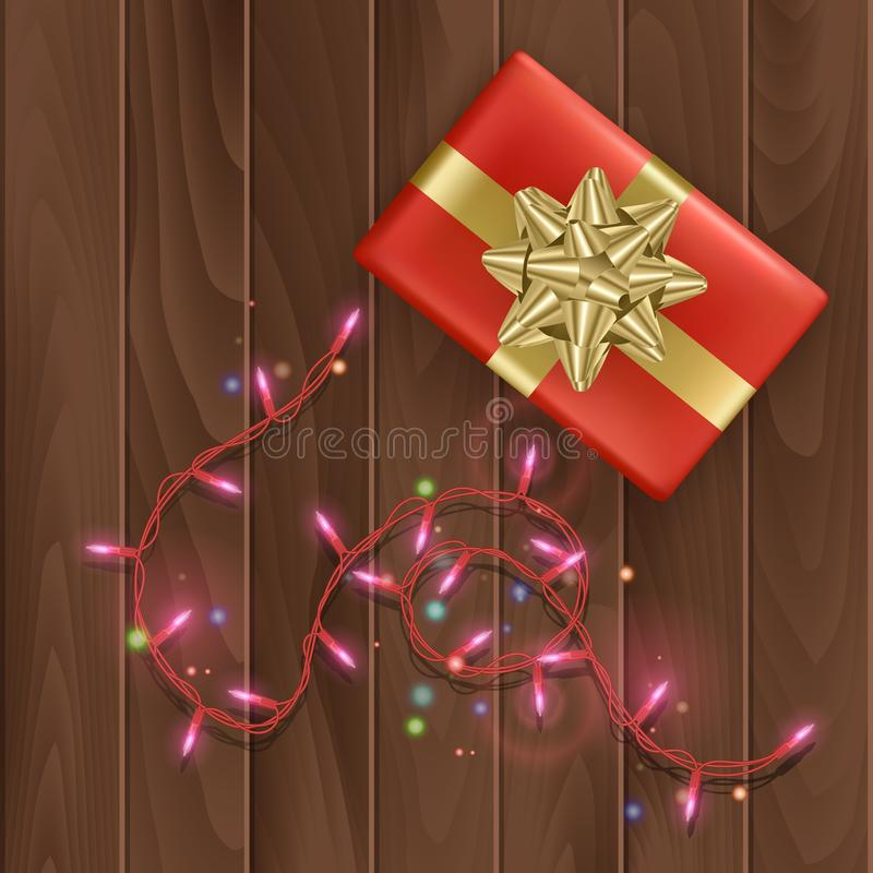 Merry christmas or happy new year day greeting card with a red gift box with gold bow on wooden background, Holiday decoration royalty free illustration