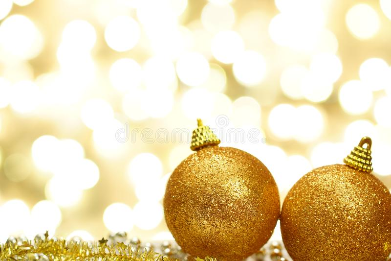 Merry Christmas and Happy New Year. Decoration ball on beige shining background stock image