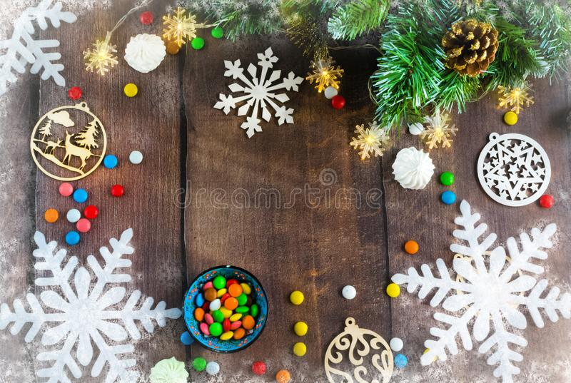 Merry Christmas and happy New year. Christmas decoration design on wooden background with candy bowl.the composition of Christmas. Merry Christmas and happy royalty free stock image