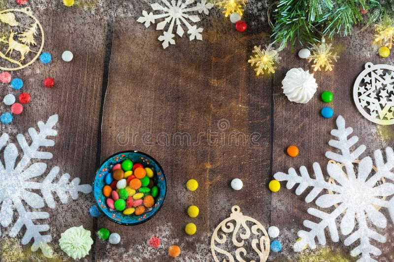 Merry Christmas and happy New year. Christmas decoration design on wooden background with candy bowl.the composition of Christmas. Merry Christmas and happy stock image