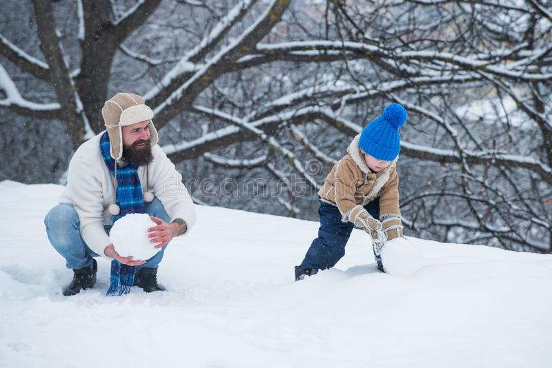 Merry Christmas and Happy New Year. Father and son play in winter clothes. Winter family in frosty winter Park. Merry Christmas and Happy New Year. Father and royalty free stock image
