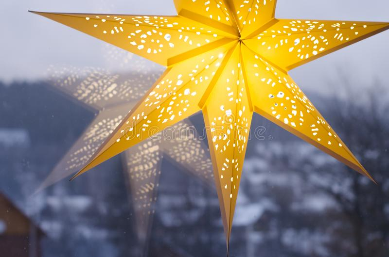 Merry Christmas and Happy New Year festive card. Christmas Star decoration . Holiday composition. Festive background royalty free stock image