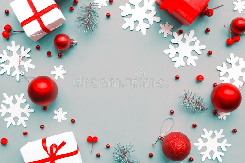 Merry Christmas and Happy New Year. Flat lay photo with Christmas decorations on blue background. Xmas greeting card, banner. stock image
