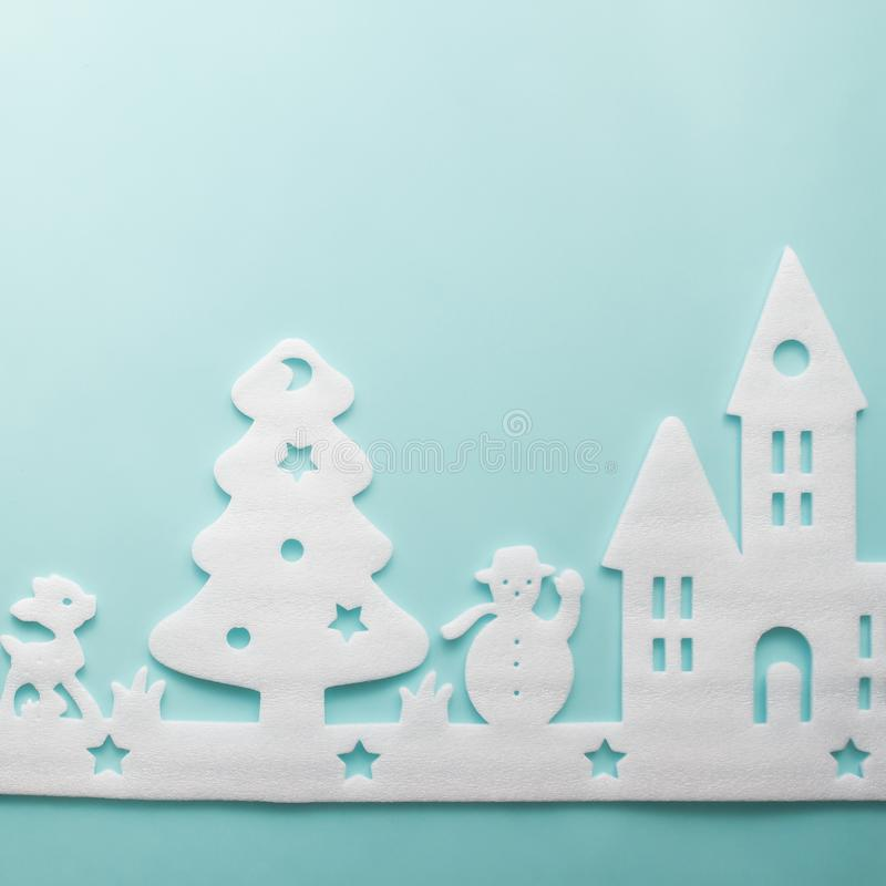 Merry Christmas and Happy New Year. Foam cutter of City, art and. Craft style on pastel color paper royalty free stock photo