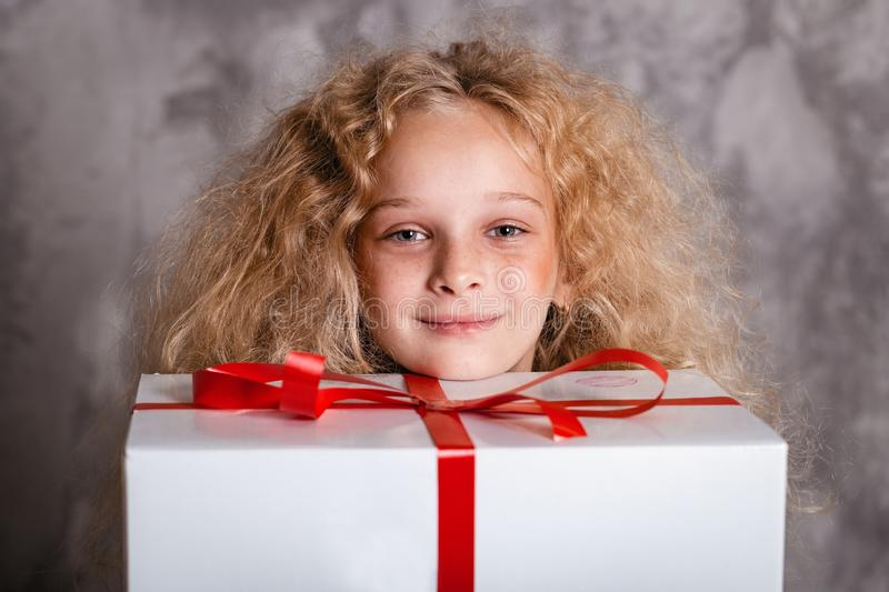 Merry Christmas and happy new year! happy girl with big present in hands looking in camera and smiling. Close portrait. Merry Christmas and happy new year! happy royalty free stock photography