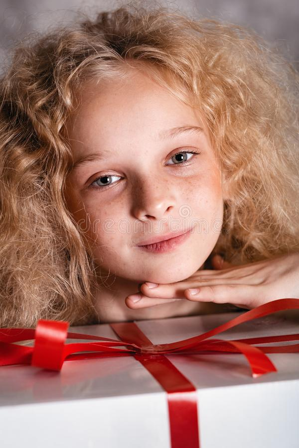 Merry Christmas and happy new year! happy girl with big present in hands looking in camera and smiling. Close portrait. Merry Christmas and happy new year! happy royalty free stock photos
