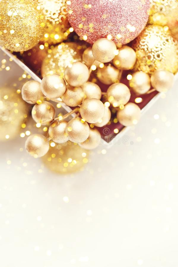 Merry Christmas and happy New year. Golden Christmas toys on a light background. Selective focus. Top view. Christmas royalty free stock images