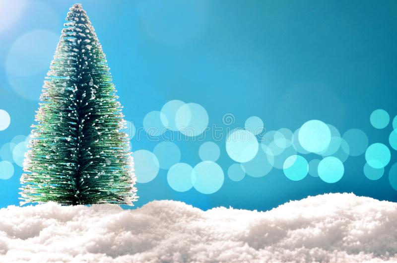 Merry christmas and happy new year greeting background with copy-space. Winter background with snow and christmas light stock photo