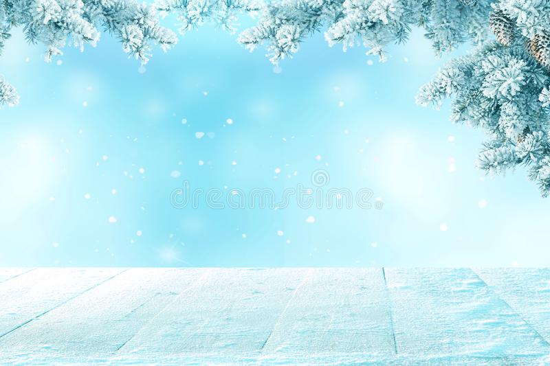 Merry christmas and happy new year greeting background. With wooden table .Winter landscape with snow and christmas trees stock photos