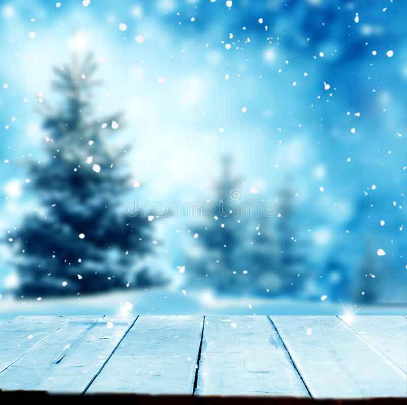 Merry christmas and happy new year greeting background with table .Winter landscape with snow and christmas trees royalty free stock photos
