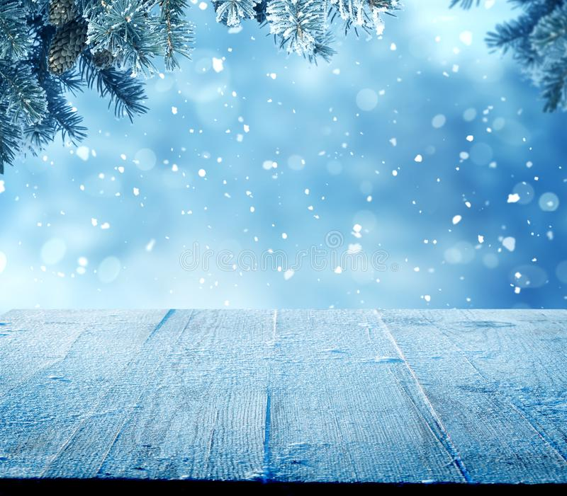 Merry Christmas and happy New Year greeting background with table. Winter landscape with fir tree branch stock images