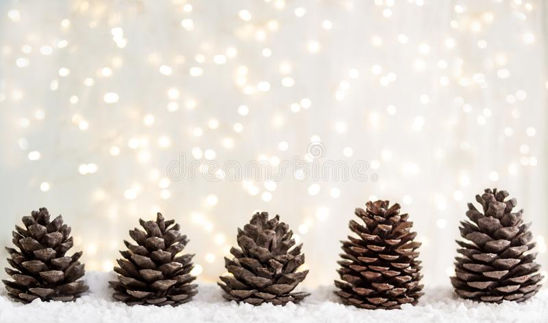 Merry christmas and happy new year greeting card with copy-space.fir cones on white snow. Winter background. Panorama royalty free stock photo