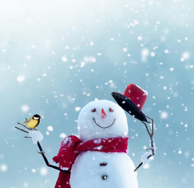 Merry christmas and happy new year greeting card with copy-space.Happy snowman standing in winter christmas landscape.Snow. Background stock image