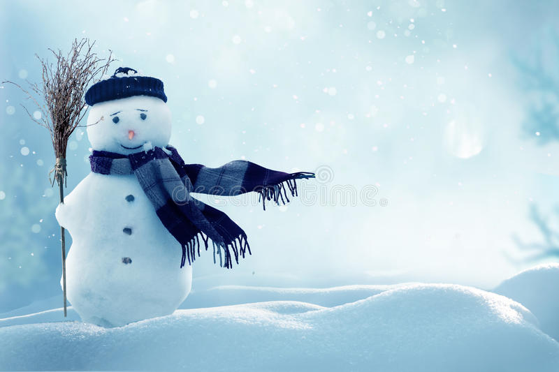 Merry christmas and happy new year greeting card with copy-space.Happy snowman standing in winter christmas. Landscape.Snow background royalty free stock photo