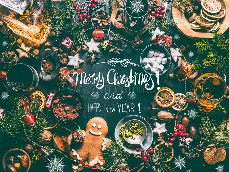 Merry Christmas and Happy New Year greeting card with text lettering and sweet food. Nuts, dried fruits, spices, broken chocolate, cookies, gingerbread, cacao royalty free stock images