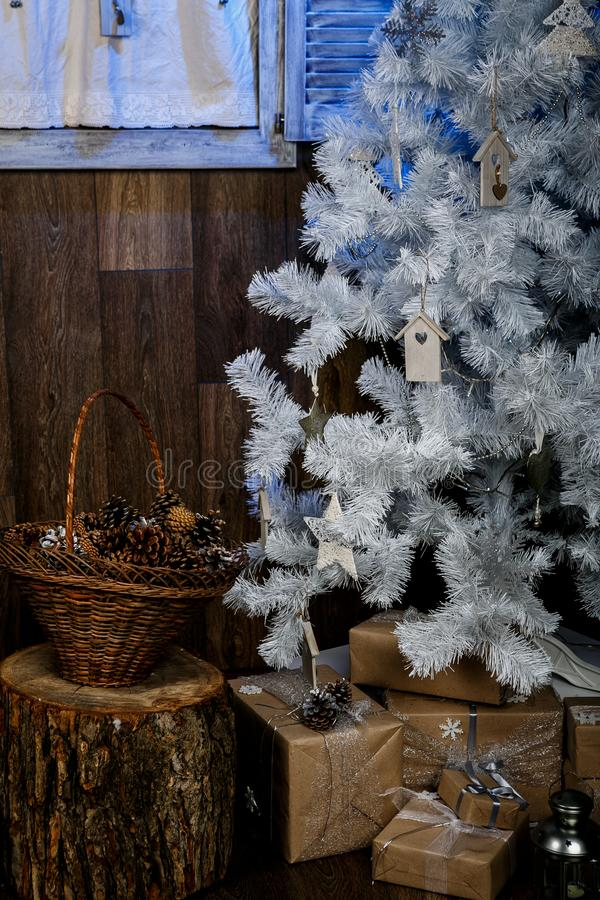 Merry Christmas and happy New Year greeting card. Christmas tree with decorations and blue light stock image