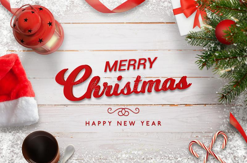 Merry Christmas and Happy New Year greeting on white wooden table. Surrounded with Christmas decorations royalty free stock photo