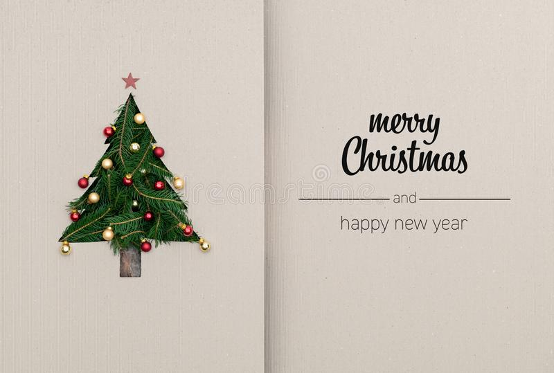 Merry Christmas and happy new year greetings in vertical top view cardboard with natural eco decorated christmas tree. Pine.Ecology concept.Xmas winter holiday royalty free stock image