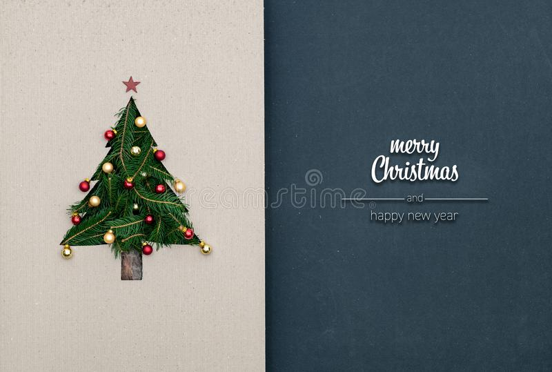 Merry Christmas and happy new year greetings in vertical top view dark blackboard with natural eco decorated christmas stock photography