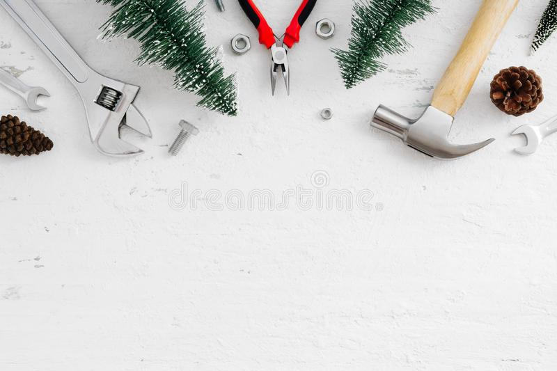 Merry Christmas and Happy new year handy tools and Christmas ornaments decoration on grunge white wood background concept. Top vi stock image