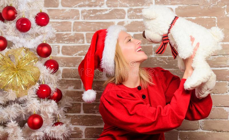 Merry christmas and happy new year. happy girl in santa claus hat. delivery xmas gifts. New year party. Smiling woman. Celebrating christmas. Christmas mood stock photos