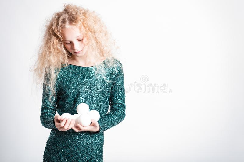 Merry Christmas and happy new year! happy girl with snow balls in hands looks very pleased. Close portrait isolated on white. Background stock photo