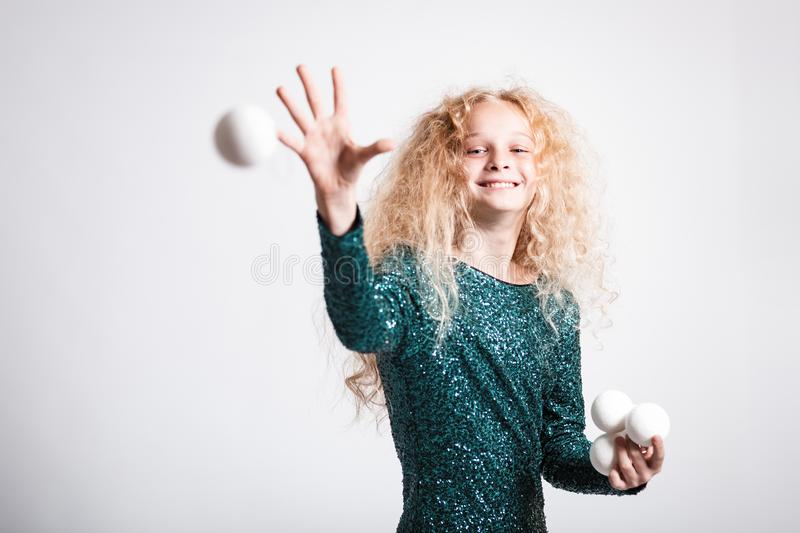 Merry Christmas and happy new year! happy girl with snow balls in hands looks very pleased. Close portrait isolated on white. Background. Girl throw snowball stock images