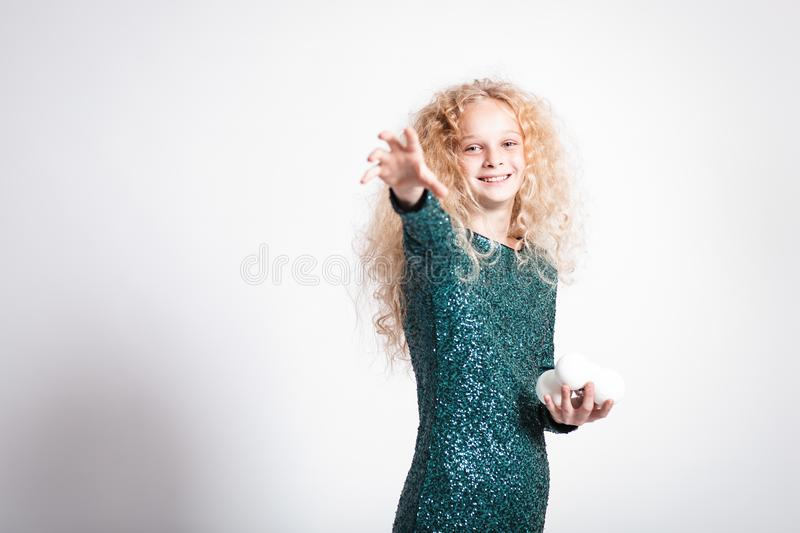 Merry Christmas and happy new year! happy girl with snow balls in hands looks very pleased. Close portrait isolated on white. Background. Girl throw snowball stock image
