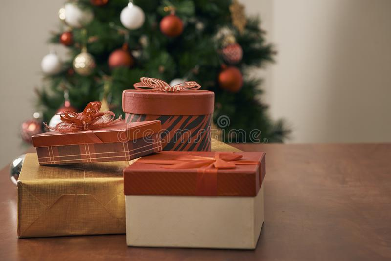 Merry Christmas and Happy New year Holidays! Decorating the Christmas tree indoors. Macro or close picture of xmas tree and gifts.  royalty free stock photography