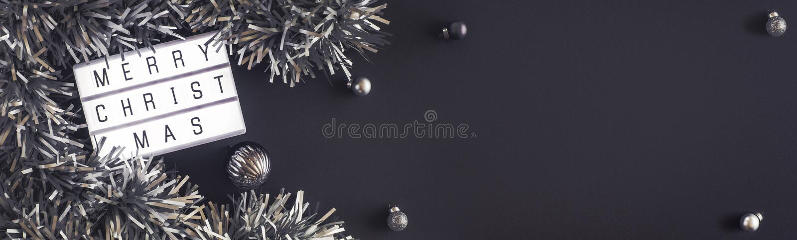 Merry christmas and happy new year lightbox on black table background.top view of tinsel,ball decorate on tabletop.holiday stock image