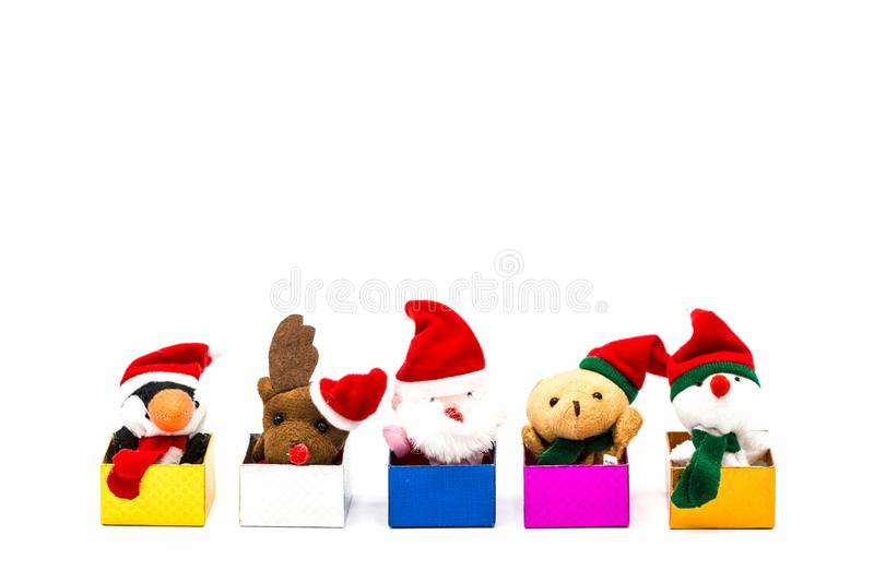 Merry christmas and happy new year 2018. Greeting card with copy-space. Santa Claus doll,Reindeer doll,Penguin dall,Teddy bear and Snowman on Christmas royalty free stock photography