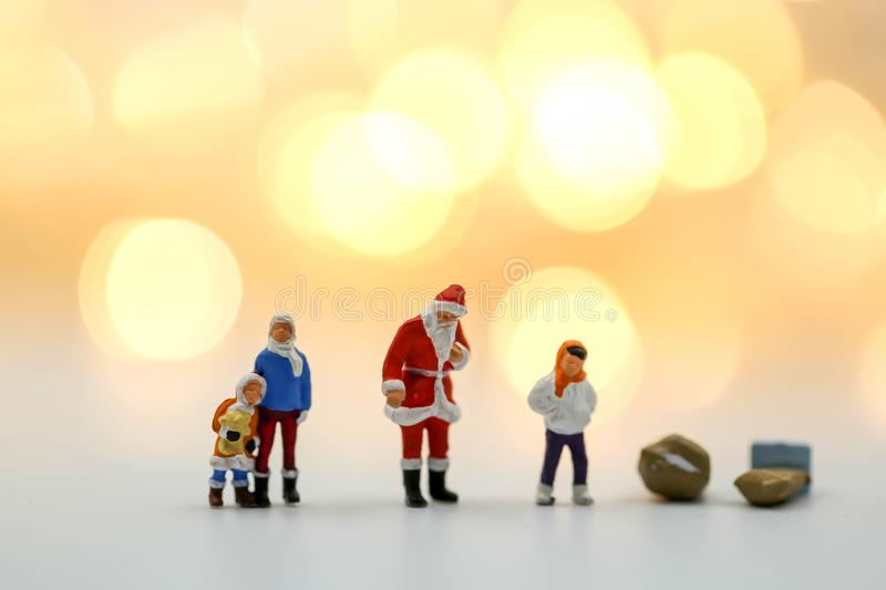 Merry christmas and happy new year Miniature People : Children w. Ith Santa Claus doll and his reindeer isolated on white background,in Christmas festival royalty free stock image