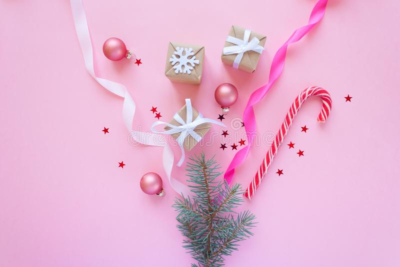 Merry Christmas and Happy New Year. Pink background. Happy new year. fireworks from Christmas elements royalty free stock photos