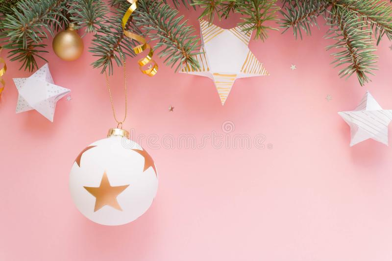 Merry Christmas and Happy New Year. Pink background. Merry Christmas and Happy New Year. Christmas Card Festive with green Fir Branches and white ball on pale stock images