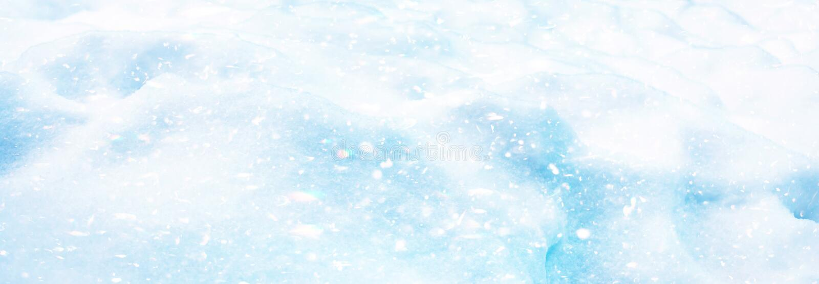 Merry Christmas and Happy New Year snow texture background with colorful shiny snowflakes in the sun.  stock photography