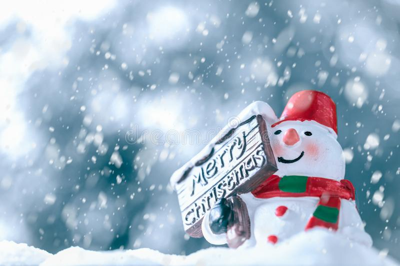 Merry Christmas and Happy New Year, Snowman with Snow Fall, happy greeting card and Christmas background concept. Merry Christmas and Happy New Year, Snowman stock photos