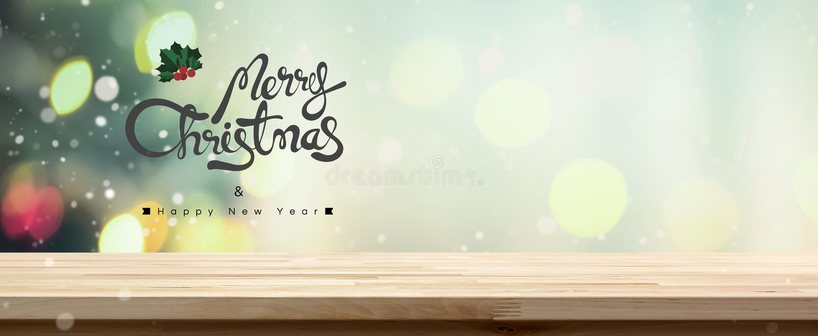 Merry Christmas and Happy New Year tabletop banner background. With colorful bokeh royalty free stock image