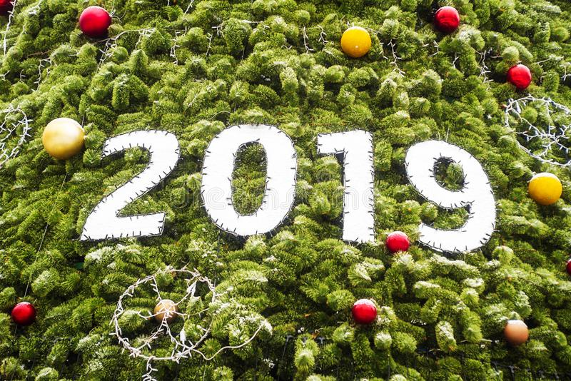 2019 Merry Christmas and happy New Year with Christmas tree as background. Happy New Year royalty free stock photo