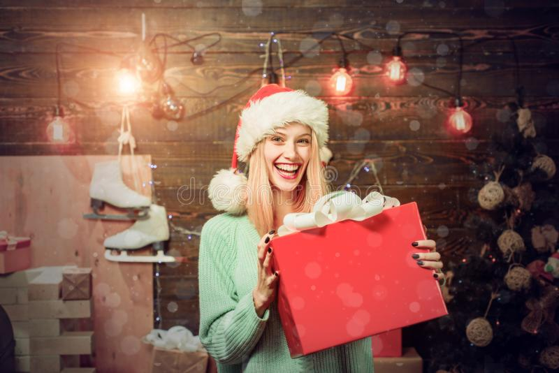 Merry Christmas and Happy New Year. Woman with christmas present boxes in front of christmas tree. Home Holiday. Winter. Eve night emotion reactions. Funny royalty free stock image