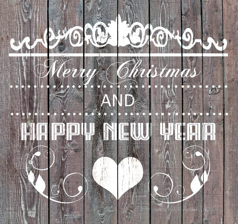 Merry Christmas and Happy New Year on wooden board. Close stock images