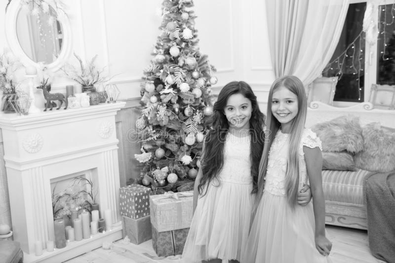 Merry Christmas and Happy New Year. xmas online shopping. Family holiday. Happy new year. Winter. The morning before. Xmas. Little girls. Christmas tree and stock photos