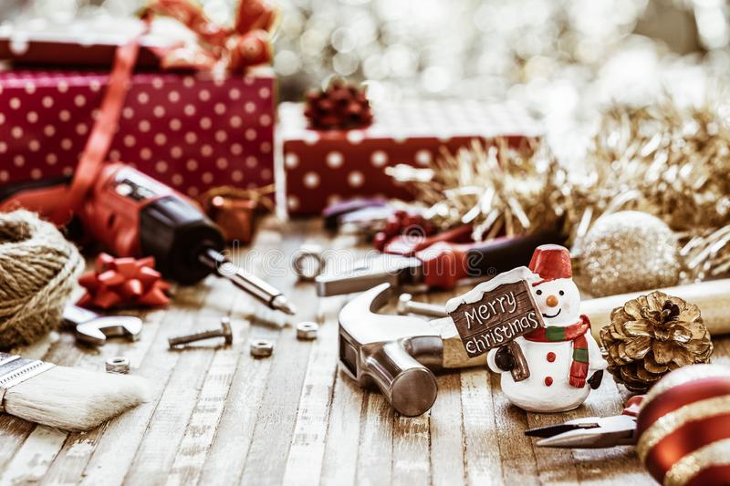 Merry Christmas and Happy New Years Handy Constrcution Tools background concept. Handy House Fix DIY handy tools with Christmas. Ornament decoration on a rustic stock images