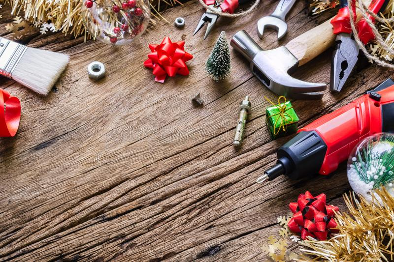 Merry Christmas and Happy New Years Handy Constrcution Tools background concept. Handy House Fix DIY handy tools with Christmas. Ornament decoration on a rustic royalty free stock image