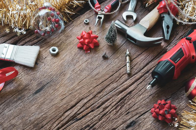 Merry Christmas and Happy New Years Handy Constrcution Tools background concept. Handy House Fix DIY handy tools with Christmas. Ornament decoration on a rustic royalty free stock photos