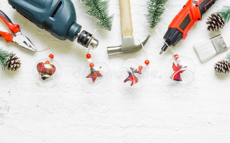 Merry Christmas and Happy New Years Handy Constrcution Tools background concept. Handy House Fix DIY handy tools with Christmas. Ornament decoration on a rustic royalty free stock photography