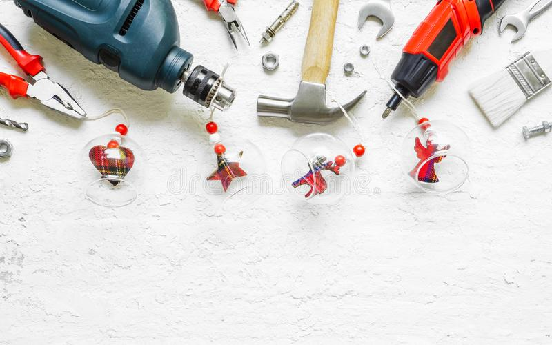 Merry Christmas and Happy New Years Handy Constrcution Tools background concept. Handy House Fix DIY handy tools with Christmas. Ornament decoration on a rustic stock photography